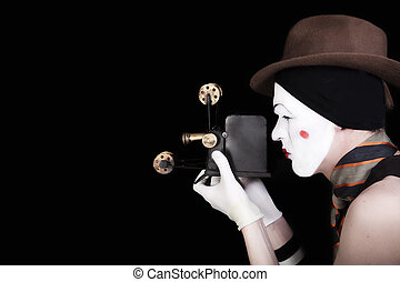 mime in white gloves and brown hat with camera - portrait of...