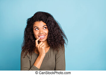 Portrait of minded interested afro american girl think about wonderful weekends have thoughts plan dream wear style pullover isolated over blue color background