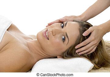 portrait of model getting head massage