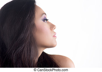 Portrait of model with black hair over white
