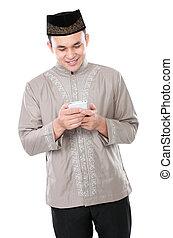 muslim man holding mobile phone