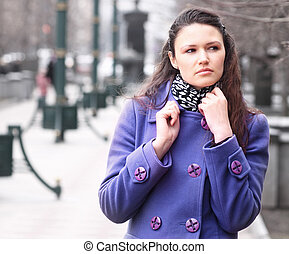 portrait of modern young woman on city background