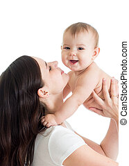 Portrait of mother and baby laughing and playing