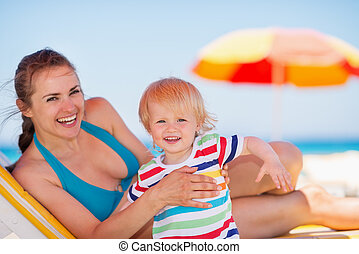 Portrait of mother and baby on beach