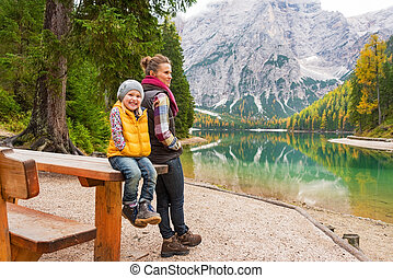 Portrait of mother and baby on lake braies in south tyrol, italy