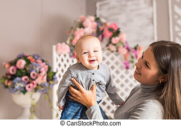 Portrait of mother and child laughing and playing
