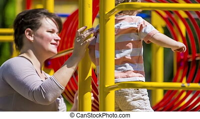 Portrait of Mother And Child On the Playground