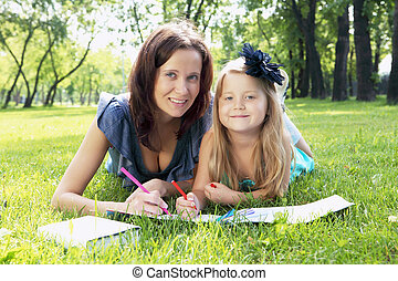 Portrait of mother and daughter in the park