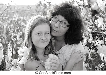 Portrait of mother and daughter outdoors