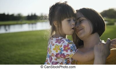 Portrait of mother and daughter playing and posing
