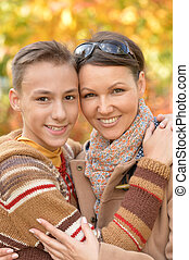 Portrait of mother and son in autumn park