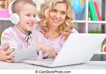 Portrait of mother and son using laptop together