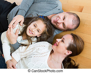 Portrait of mother, father and girl