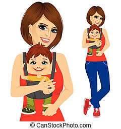 mother holding little boy with baby carrier
