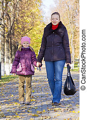 mother with her girl in autumn park
