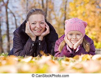 mother with her girl in autumn