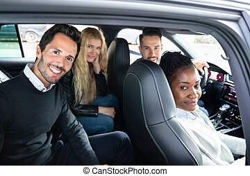 Portrait Of Multi Racial Friends Sitting In Car