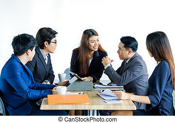 Portrait Of Multiracial Businesspeople Brainstorming In Meeting