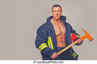 Portrait of muscle man in fireman uniform
