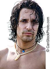 Portrait of muscular male model on the beach