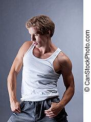 Portrait of muscular young hip hop dancer