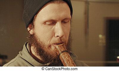 Portrait of musician plays the flute