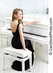 Portrait of musician sitting and playing piano