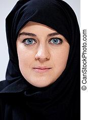Portrait of muslim woman in black headscarf