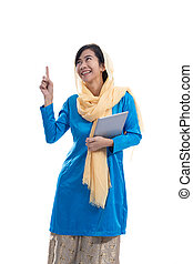 muslim woman thinking and looking up pointing to copyspace