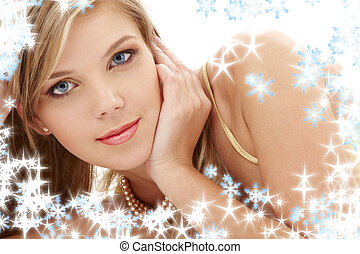 portrait of mysterious blue-eyed blond in pearls