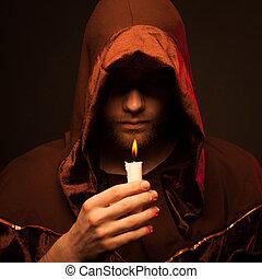 Portrait of mystery unrecognizable monk in robe