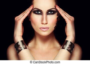 Portrait of mystic woman with extravagant makeup. Retouched...