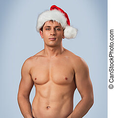 portrait of naked male in santa cap