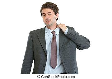 Portrait of nervous modern businessman