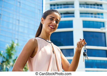 Portrait Of New House Owner Holding Apartment Keys