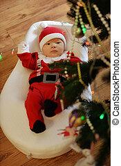 newborn baby boy wearing Santa clothes