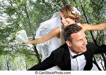 newlywed couple happy together - portrait of newlywed couple...