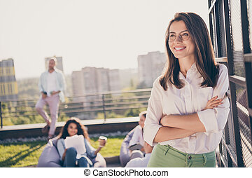 Portrait of nice attractive stylish entrepreneur leader shark expert specialist folded arms on roof outside outdoor sunny day