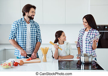 Portrait of nice lovely attractive cheerful cheery kind people mum dad pre-teen kid making fresh useful salad dish soup cuisine in light white interior indoors