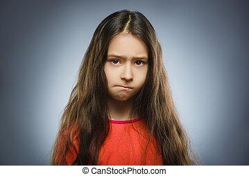 Portrait of offense girl. Negative human emotion