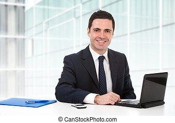 Portrait of office worker at desk