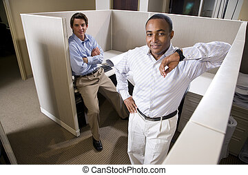 Portrait of office workers in empty cubicle