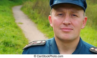 portrait of officer of rescue service standing in park