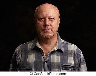 old bald man over black background