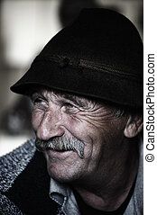 Portrait of old man with mustache, aged photo