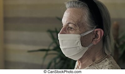 Portrait of old woman in face mask on quarantine