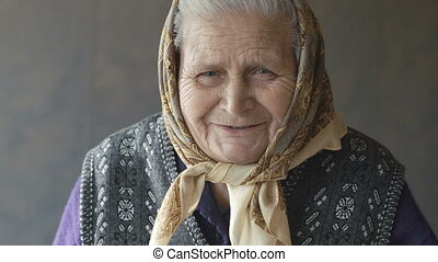 Portrait of old wrinkled woman smiling at camera