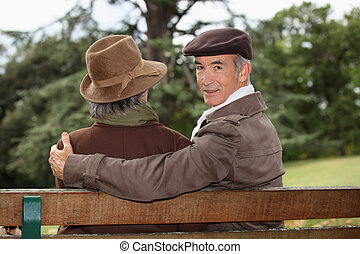 portrait of older people on a bench