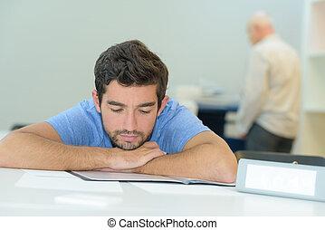 portrait of overworked businessman sleeping in office