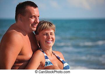 portrait of pair against sea